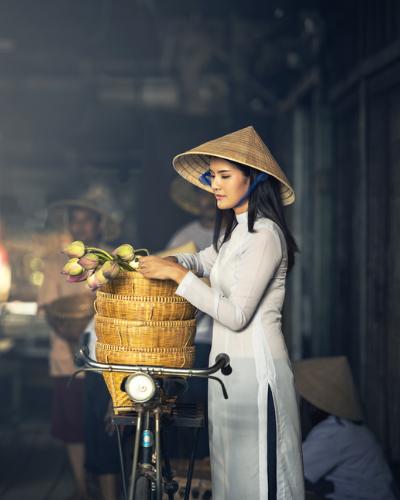 Vietnamese woman and bike Vietnam
